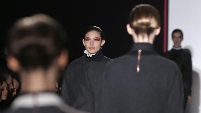 Models present creations by Belgium designer Cedric Charlier for his Ready to Wear Fall-Winter 2013-2014 fashion collection, in Paris, Tuesday, Feb.26, 2013. (AP Photo/Christophe Ena)