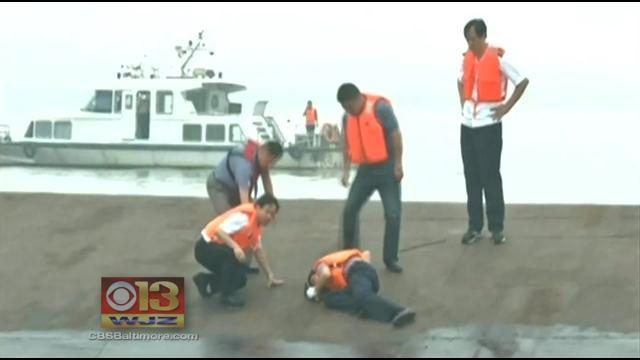 Relatives of China boat passengers turn anger on govt