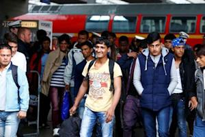Migrants arrive by train at main station in Munich