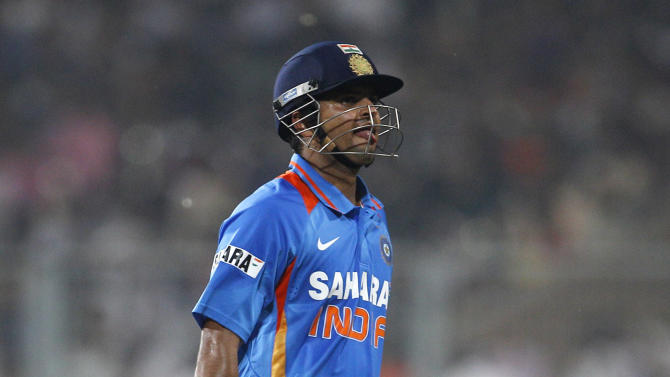 India's batsman Suresh Raina reacts as he leaves the ground after losing his wicket during their Twenty20 international cricket match against England in Kolkata, India, Saturday, Oct. 29, 2011. (AP Photo/Aijaz Rahi)