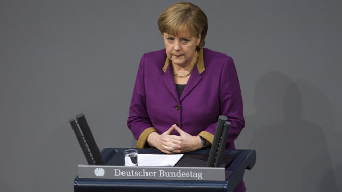 "German Chancellor Angela Merkel delivers her speech prior to the debate and the voting of the German Parliament Bundestag about a new Greek rescue package in Berlin, Germany, Monday, Feb. 27, 2012. Merkel urged German lawmakers to support the new rescue package on, though she conceded that there is no ""100 percent guarantee"" it will succeed. (AP Photo/Markus Schreiber)"
