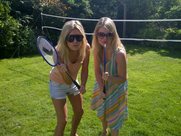 Mollie King in the garden with her sister