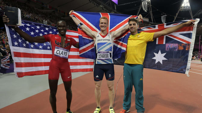 Britain's gold medal winner Greg Rutherford is flanked by Australia's silver medalist Mitchell Watt, right, and United States' bronze medalist Will Claye after the men's long jump during athletics competition in the Olympic Stadium at the 2012 Summer Olympics, Saturday, Aug. 4, 2012, in London.  (AP Photo/David J. Phillip )