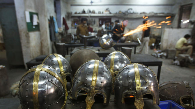 In this, June 2, 2012 photograph, helmets being prepared for a Hollywood period movie are kept together at a workshop owned by Indian businessman Ashok Rai, unseen, in Sahibabad, India. From Hollywood war movies to Japanese Samurai films to battle re-enactments across Europe, Rai is one of the world's go-to men for historic weapons and battle attire. (AP Photo/Saurabh Das)