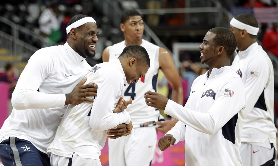 USA's Kobe Bryant, left, jokes with teammates  Russell Westbrook, center and Chris Paul, right, following a preliminary men's basketball game against Nigeria at the 2012 Summer Olympics, Friday, Aug. 3, 2012, in London. (AP Photo/Eric Gay)