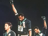 Peter Norman (L) may receive a posthumous apology over the Black Power protest at the 1968 Olynpics