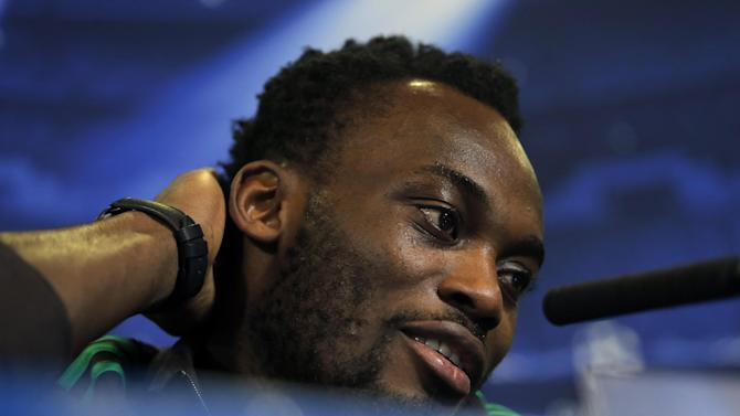 AC Milan's Michael Essien speaks during a press conference ahead of Tuesday's Champions League, round of 16, second leg, soccer match against Atletico Madrid at the Vicente Calderon stadium, in Madrid, Spain, Monday, March. 10, 2014