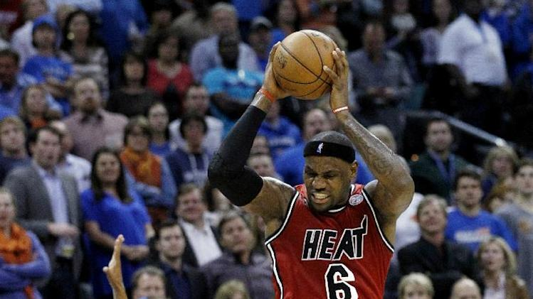 Miami Heat forward LeBron James reacts to a whistle in the second quarter of an NBA basketball game against the Oklahoma City Thunder in Oklahoma City, Thursday, Feb. 14, 2013. (AP Photo/Sue Ogrocki)