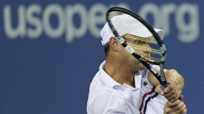 Andy Roddick returns a shot to Argentina's Juan Martin Del Potro in the fourth round of the 2012 US Open tennis tournament,  Tuesday, Sept. 4, 2012, in New York. (AP Photo/Charles Krupa)