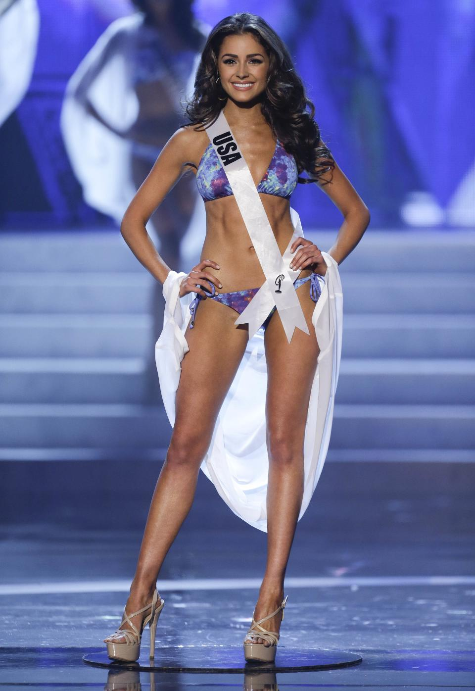 Miss USA Olivia Culpo takes center stage as she is announced as one of the five finalists during the Miss Universe pageant, Wednesday, Dec. 19, 2012, in Las Vegas. Culpo was crowned as Miss Universe. (AP Photo/Julie Jacobson)