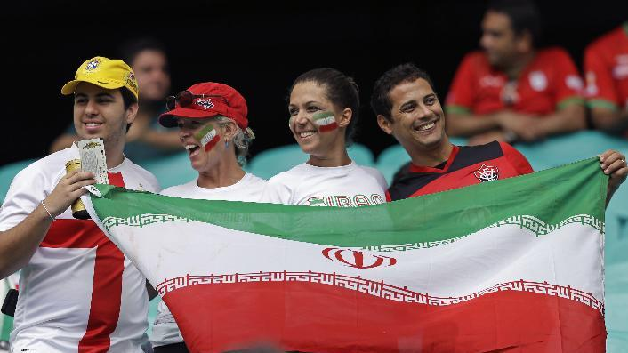 Iran's fans hold a flag before the group F World Cup soccer match between Bosnia and Iran at the Arena Fonte Nova in Salvador, Brazil, Wednesday, June 25, 2014