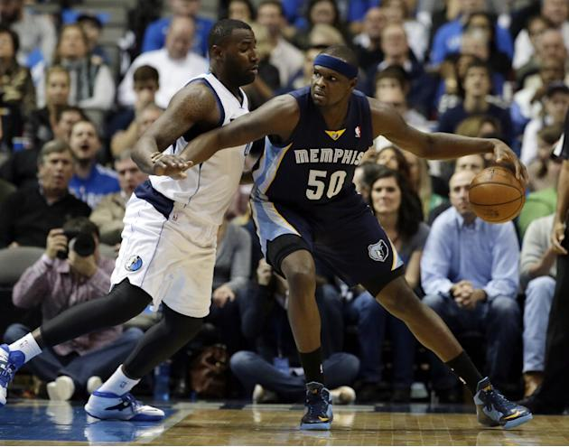 Dallas Mavericks' DeJuan Blair, left, defends as Memphis Grizzlies power forward Zach Randolph (50) looks for an opening to the basket in the first half of an NBA basketball game on Wednesday, Dec