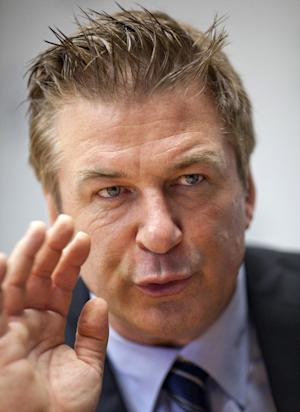 Alec Baldwin gestures during an interview with The Associated Press in Washington, Monday, April 16, 2012, Alec Baldwin is going to Congress to ask for sustained federal funding for arts programs amid the ever tight budget climate. Baldwin and Folds talk with AP ahead of their visits to congressional offices on Tuesday. (AP Photo/J. Scott Applewhite)