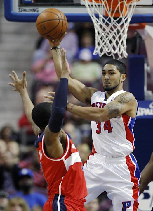Detroit Pistons guard Peyton Siva (34) passes the ball against Washington Wizards guard Bradley Beal (3) during the first half of a preseason NBA basketball game Tuesday, Oct. 22, 2013, in Auburn Hill