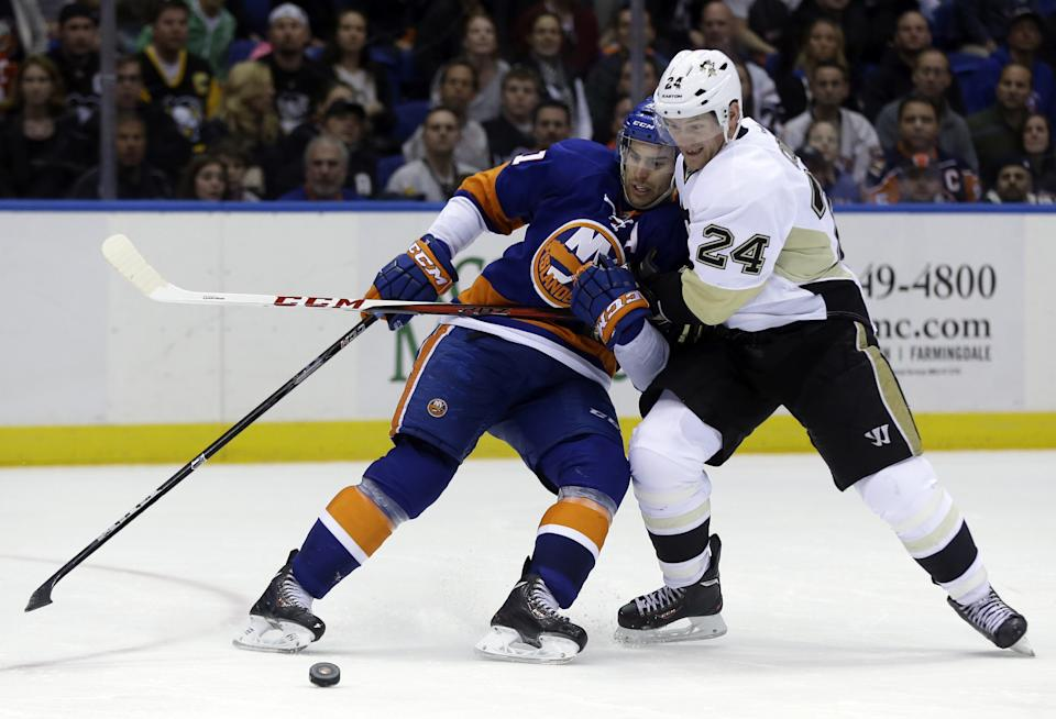 Pittsburgh Penguins' Matt Cooke, right, takes down New York Islanders' John Tavares during the third period of Game 3 of an NHL hockey Stanley Cup first-round playoff series on Sunday, May 5, 2013, in Uniondale, N.Y. (AP Photo/Seth Wenig)