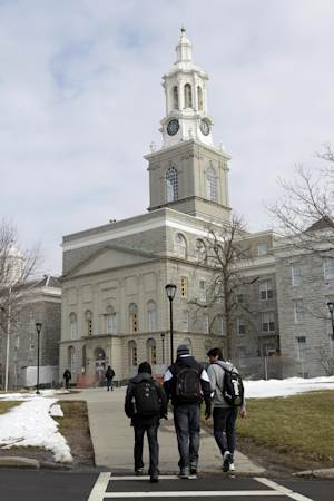 In this Wednesday, Feb. 15, 2012 photo, people walk on the University at Buffalo campus in Buffalo, N.Y. The New York Police Department monitored Muslim college students far more broadly than previously known, at schools far beyond the city limits, including the University at Buffalo, the Ivy League colleges of Yale and the University of Pennsylvania, The Associated Press has learned. (AP Photo/David Duprey)