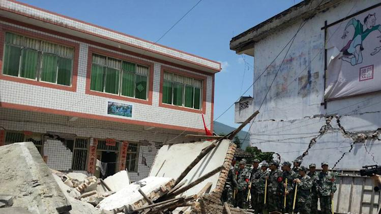 In this photo released by China's Xinhua news agency, buildings are destroyed by a powerful earthquake at Gucheng village of Longmen Township of Lushan County in Ya'an City, southwest China's Sichuan Province, Saturday, April 20, 2013. The powerful earthquake jolted Sichuan province Saturday near where a devastating quake struck five years ago. (AP Photo/Xinhua, Hai Mingwei) NO SALES