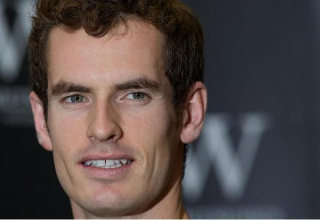 Andy Murray poses for pictures as he launches his new book 'Andy Murray: Seventy-Seven: My Road to Wimbledon Glory' at a bookstore in London, on November 6, 2013