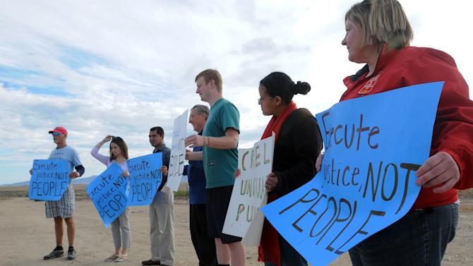 A small group of protesters gather outside the Idaho Department of Corrections in opposition to the scheduled execution of Richard Leavitt on Tuesday, June 12, 2012 in Kuna.  Prison officials declared Leavitt, 53,  dead at 10:25 a.m. Tuesday by lethal injection at the Idaho Maximum Security Institution. It was only Idaho's second execution in 17 years.  Leavitt was convicted of stabbing 31-year-old Danette Elg, of Blackfoot, in 1984.  (AP Photo/Idaho Press-Tribune, Greg Kreller) MANDATORY CREDIT