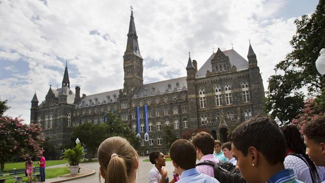 FILE - In this July 10, 2013, file photo, prospective students tour Georgetown University's campus in Washington. Despite all the grumbling about tuition increases and student loan costs, other college expenses also are going up. The price of housing and food trumps tuition costs for students who attend two- and four-year public universities in their home states. That's according to a College Board survey. Even with the lower interest rates on student loans that President Barack Obama signed into law, students are eyeing bills that are growing on just about every line. (AP Photo/Jacquelyn Martin, File)