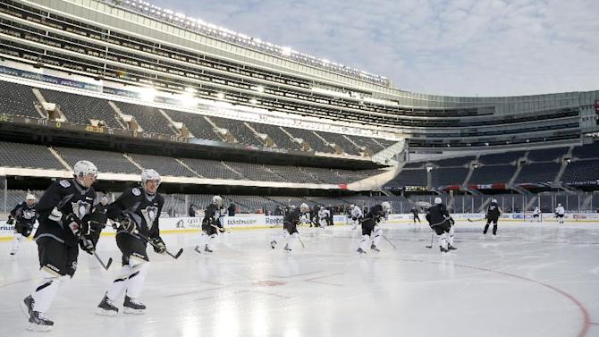 The Pittsburgh Penguins practice on the Soldier Field ice for Saturday's Stadium Series NHL hockey game between the Penguins and the Chicago Blackhawks, Friday, Feb. 28, 2014, in Chicago
