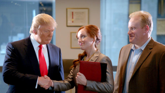 """This advertisement provided by Century 21, shows a scene from the ad """"Smarter, Bolder, Faster,"""" with a Century 21 saleswoman and real estate tycoon Donald Trump, left. The ad will air during Super Bowl XLVI, Sunday, Feb. 5, 2012. (AP Photo/Century 21)"""