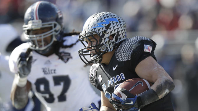 Air Force running back Cody Getz (28) runs against Rice defensive end Jared Williams (97) during the first half of the Armed Forces Bowl NCAA college football game Saturday, Dec. 29, 2012, in Fort Worth, Texas. (AP Photo/LM Otero)