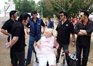 Elvis Presley tribute artists gather around Elvis fan Yvonne Robertson during Elvis Week at Graceland in Memphis, Tennessee. This year's Elvis Week marks the 35th anniversary of the death of the King of Rock and Roll, and organizers expect it will be the largest ever