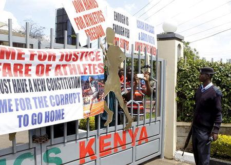 A policeman is seen outside the gates of Riadha House the Athletic Kenya Headquarters during a protest in capital Nairobi