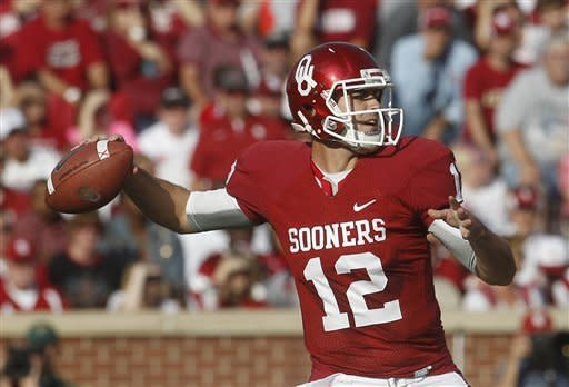 Jones, No. 14 Sooners hold off Baylor 42-34
