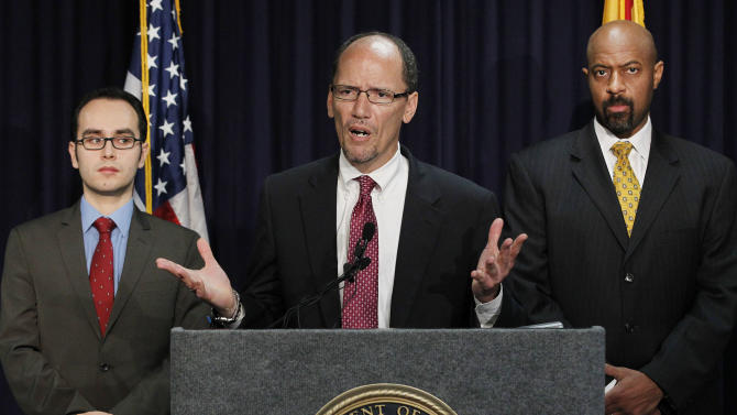 United States Assistant Attorney General Thomas Perez, middle, who heads up the civil rights division at the Department of Justice, is joined by Deputy Assistant Attorney General for Civil Rights, Roy Austin, right, and Sergio Perez, attorney for the Civil Right Division at the Department of Justice, as Perez announces a federal civil lawsuit against Maricopa County Sheriff Joe Arpaio, his office, and the county, at a news conference Thursday, May 10, 2012, in Phoenix. After months of negotiations failed to yield an agreement to settle allegations that his department racially profiled Latinos in his trademark immigration patrols. (AP Photo/Ross D. Franklin)