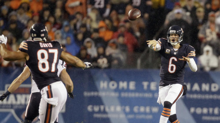 Chicago Bears quarterback Jay Cutler (6) passes to tight end Kellen Davis (87) during the first half an NFL football game against the Houston Texans, Sunday, Nov. 11, 2012, in Chicago. Davis fumbled after the reception and the Texans recovered. (AP Photo/Nam Y. Huh)