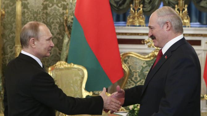 Russia's President Putin and his Belarussian counterpart Lukashenko attend a session of the Supreme State Council of the Union State at the Kremlin in Moscow