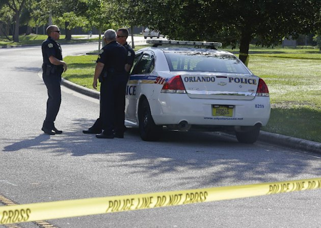 Police officers block the entrance to an apartment complex where man was fatally shot, Wednesday, May 22, 2013, in Orlando, Fla. The FBI says the man, being questioned by authorities in the Boston bom