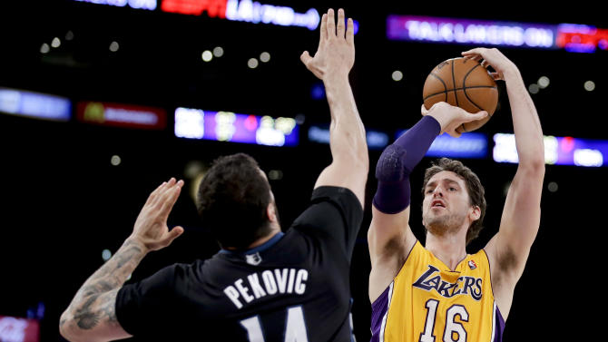 Los Angeles Lakers center Pau Gasol shoots over Minnesota Timberwolves center Nikola Pekovic during the first half of an NBA basketball game in Los Angeles, Friday, Dec. 20, 2013. (AP Photo/Chris Carlson)