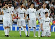 Real Madrid's players, pictured after the penalty shoot-out during their Champions League 2nd leg semi-final against Bayern Munich, at the Santiago Bernabeu in Madrid, on April 25. Spanish hopes of a mouth watering final between Real and Barcelona evaporated with both sides crashing out but at least Real have the consolation of being on the verge of claiming their first la liga title since 2008