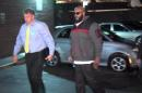 "This image from video shows Death Row Records founder Marion ""Suge"" Knight, right, walking into the Los Angeles County Sheriffs department early Friday morning Jan. 30, 2015 in connection with a hit-and-run incident that left one man dead and another injured. Man at left is an unidentified police officer. (AP Photo/OnSceneVideo via AP Television)"