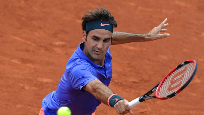 Roger Federer begins his 62nd consective Grand Slam with a 6-3, 6-3, 6-4 win over Colombian 'lucky loser' Alejandro Falla