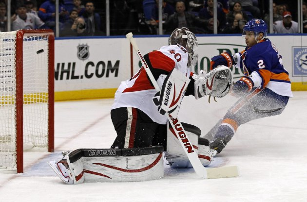 New York Islanders defenseman Streit looks on as a shot by Islanders center Boyes gets past Ottawa Senators goalie Lehner in first period of their NHL hockey game in Uniondale