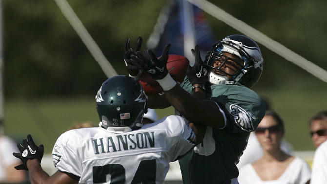 Philadelphia Eagles' Gerald Jones makes a catch as teammate Joselio Hanson (21) defends during the morning session of NFL football training camp at Lehigh University in Bethlehem, Pa., on Sunday, July 31, 2011. (AP Photo/Rich Schultz)
