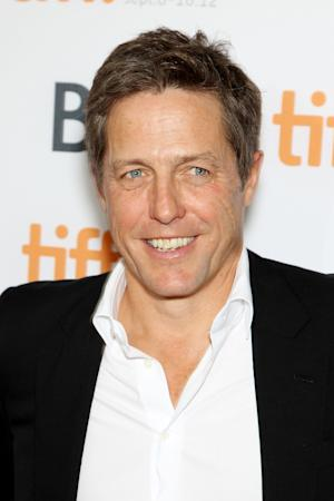 """FILE- This Sept. 8, 2012 file photo provided by Starpix shows actor Hugh Grant at the premiere of """"Cloud Atlas,"""" at the Toronto International Film Festival. Lord Justice Brian Leveson will release his report, Thursday, Nov. 29 2012, on a year-long inquiry into the culture and practices of the British press and his recommendations for future regulation to prevent phone hacking, data theft, bribery and other abuses. (AP Photo/Starpix, Marion Curtis, File)"""