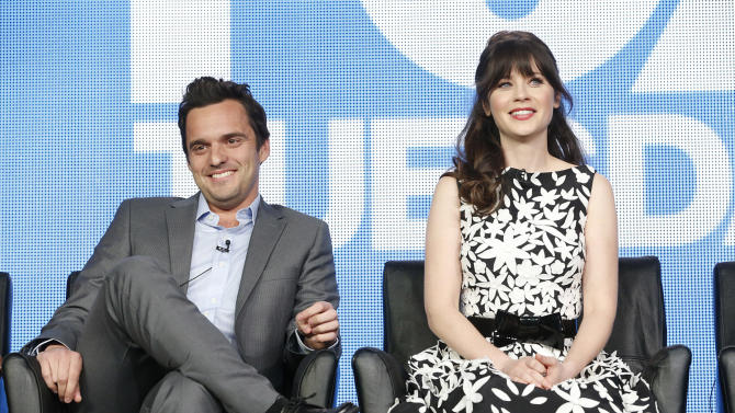 Jake Johnson and Zooey Deschanel attend the Fox Winter TCA Tour at the Langham Huntington Hotel on Tuesday, Jan. 8, 2013, in Pasadena, Calif. (Photo by Todd Williamson/Invision/AP)