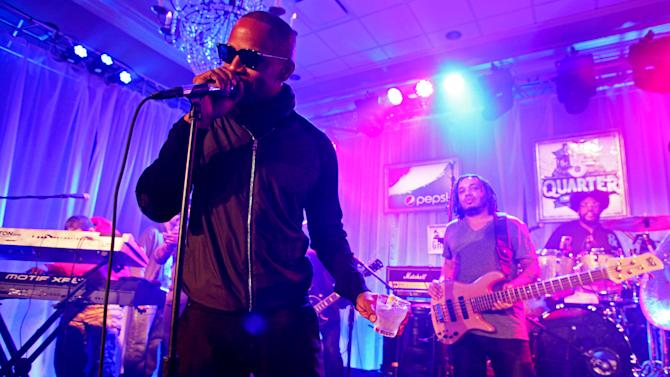 IMAGE DISTRIBUTED FOR PEPSI - Jamie Foxx with Mark Kelley and ?uestlove of The Roots perform at the Pepsi 5th Quarter in the French Quarter Post Super Bowl Party, on Sunday, Feb. 3, 2013, in New Orleans. (Photo by Barry Brecheisen/Invision for Pepsi/AP Images)