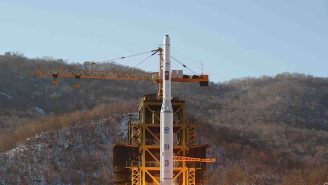 FILE - In this Dec. 12, 2012 file photo released by Korean Central News Agency, North Korea's Unha-3 rocket lifts off from the Sohae launch pad in Tongchang-ri, North Korea. The upcoming regional security summit in this tiny Southeast Asian sultanate is the sort of venue where North Korea has often managed to open up sideline discussions with Seoul and Washington. This time, while there will be plenty of talk about Pyongyang, there is little chance of substantive talk with it. (AP Photo/KCNA, File)