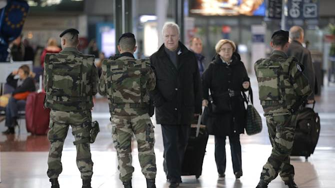 French soldiers patrol at Nice airport, southern France,  Sunday, Jan.13, 2013. Sunday, Jan. 13, 2013. France's president says his country will raise its domestic terror threat level because of French military operations against Islamist forces in two African countries. Hollande says he will increase security at public buildings and across France's extensive transportation networks. (AP Photo/Lionel Cironneau)