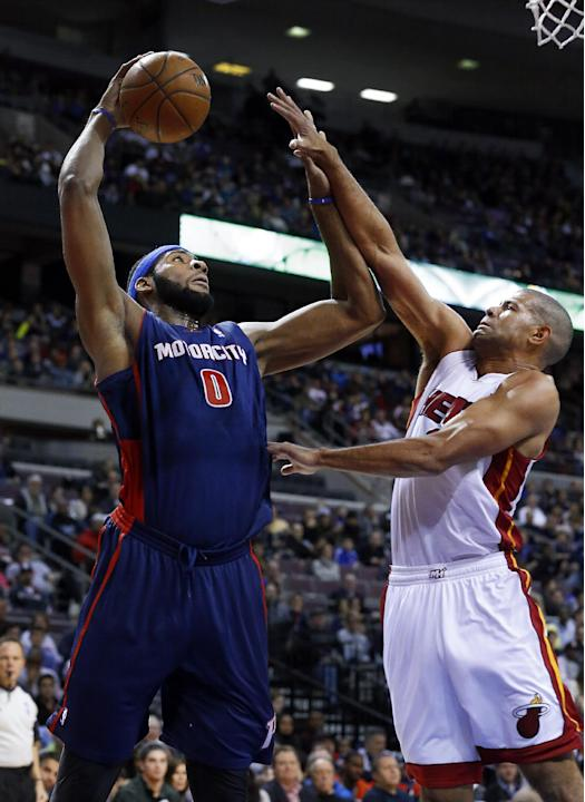 Detroit Pistons center Andre Drummond (0) shoots over Miami Heat small forward Shane Battier in the first quarter of an NBA basketball game in Auburn Hills, Mich., Sunday, Dec. 8, 2013