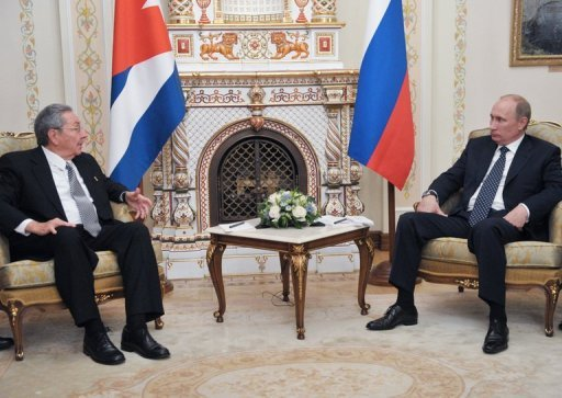 <p>Russia's President Vladimir Putin (R) speaks with visiting Cuban leader Raul Castro as they meet in the Novo-Ogaryovo residence outside Moscow. Castro sought on Wednesday to revive an historic but flagging friendship with Russia as he met Putin for talks on economic relief for his sanctions-plagued communist state.</p>