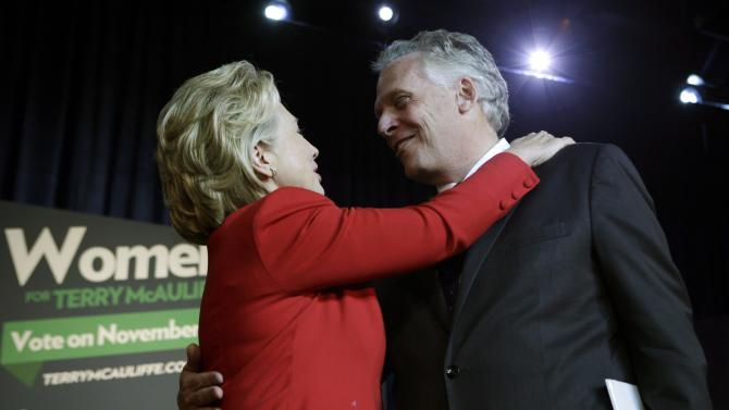 Former U.S. Secretary of State Hillary Clinton greets former DNC chairman Terry McAuliffe at The State Theatre in Falls Church
