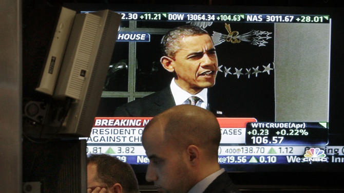 FILE - In this Tuesday, March 13, 2012 file photo, President Barack Obama's speech is shown on a television monitor on the floor of the New York Stock Exchange, in New York. In 2012, stocks wavered ahead of a presidential election that at times seemed too close to call, and while Obama ultimately reclaimed the White House by a comfortable margin, the Republicans retained control of the House. (AP Photo/Richard Drew, File)