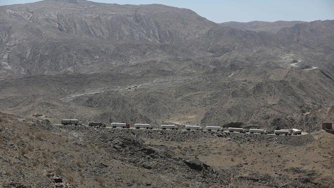 Tanker trucks are stuck on an unpaved road as they take a detour from the main road due to fighting between pro-government forces and Houthi rebels, in Yemen's northern province of Marib